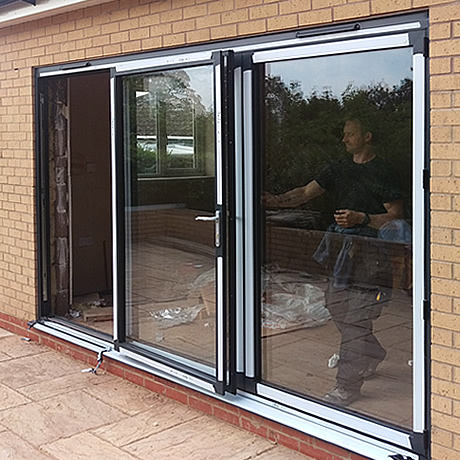 A 3 pane Smart Aluminium bi-folding large leaf door in anthracite grey finish installed in Stechford, Birmingham, www.solihullwindows.co.uk