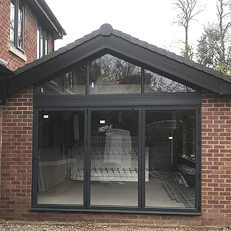 A Smart Aluminium bi-folding door finished in anthracite grey finish installed in St. Bearnards Road, Solihull
