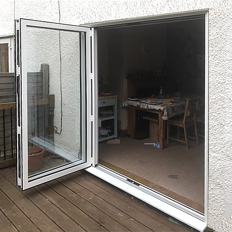 A 2 pane Smart Aluminium bi-folding door finished in White installed in solihull, www.solihullwindows.co.uk