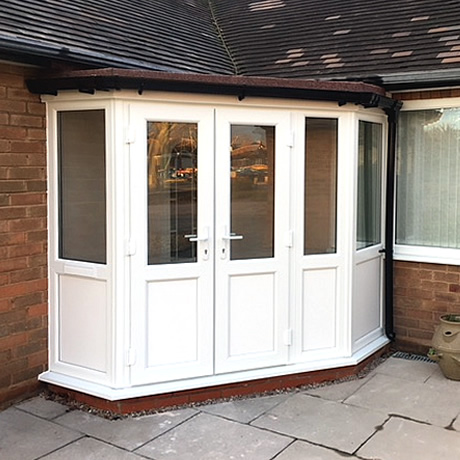Newbuild angled entrance porch built and installed with French doors and flat felted roof located in Solihull