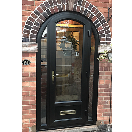 Arched porch entrance in all black profile from solihull windows....