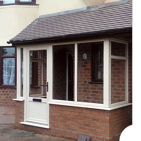 A newbuild entrance porch with cream profile completed with a pitched and tiled roof, installed in Hollywood by Solihull WDC