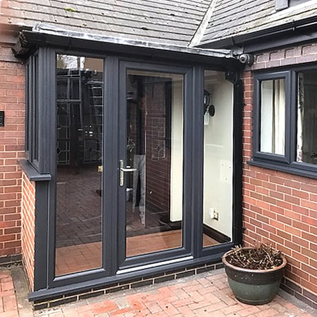 Stylish entrance porch finished in anthracite grey profile installed in Solihull by Solihull WDC