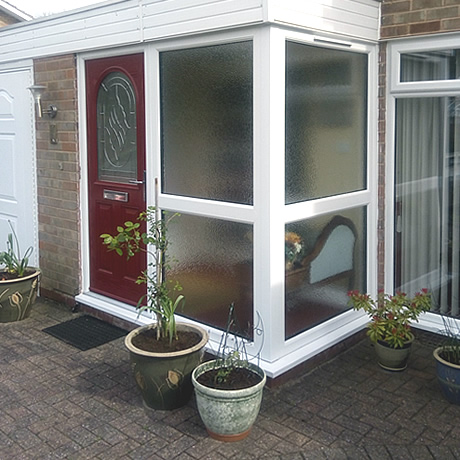 Replacement entrance porch installed with feature red composite door located in Hollywood, www.solihullwindows.co.uk