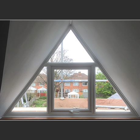 Double glazed triangular shaped windows installed at high-level in birmingham, www.solihullwindows.co.uk