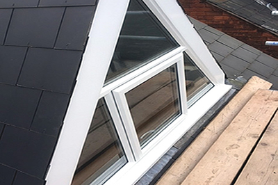 a triangular shaped window with a top hung opening by Solihull WDC, from solihullwindows.co.uk