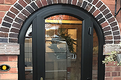 Arched entrance porch in all black Liniar woodgrain profile by Solihull WDC